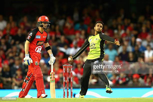 Arjun Nair of the Thunder bowls during the Big Bash League match between the Melbourne Renegades and Sydney Thunder at Etihad Stadium on December 22...