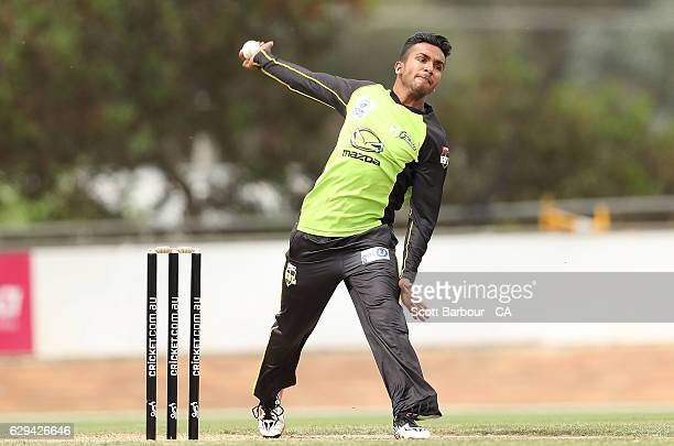 Arjun Nair of the Thunder bowls during the Twenty20 Border Bash match between the Melbourne Stars and the Sydney Thunder at Lavington Sports Ground...