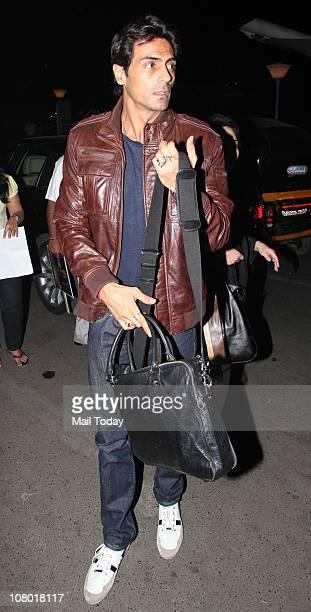 Arjun Rampal at Mumbai Airport leaving for Zee Cine Awards 2011 to be held at Singapore