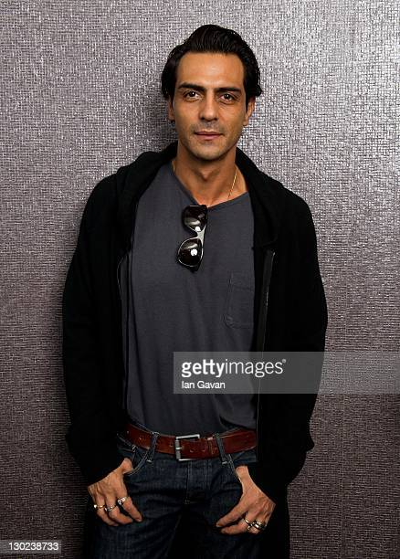 Arjun Rampal poses for a portrait before the premiere of the Bollywood film 'RA One' at the Montcalm Hotel on October 25 2011 in London England
