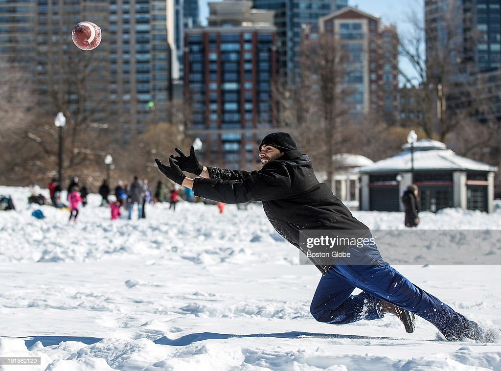Arjun Rao, 30, of Boston, played catch with a football on Boston Common after a blizzard dropped over two feet of snow in the area, Sunday, Feb. 10, 2013.