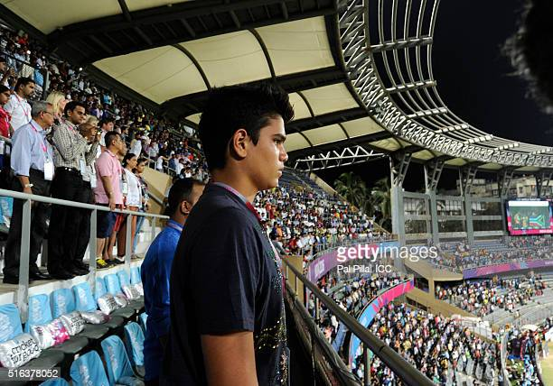 Arjun Tendulkar son of Indian cricketer Sachin Tendulkar stands during the national anthem before the start of the ICC World Twenty20 India 2016...