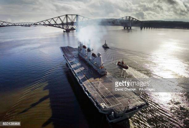 HMS Ark Royal departs for sea trials from Rosyth dock yard under the Forth Rail Bridge