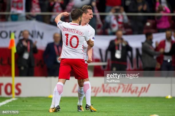 Arkadiusz Milik and Maciej Makuszewski of Poland celebrate scoring during the FIFA World Cup 2018 Qualifying Round match between Poland and...