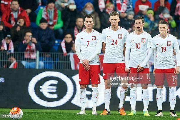 Arkadiusz Milik Bartosz Salamon Grzegorz Krychowiak and Piotr Zielinski all of Poland look at the ball during the international friendly soccer match...