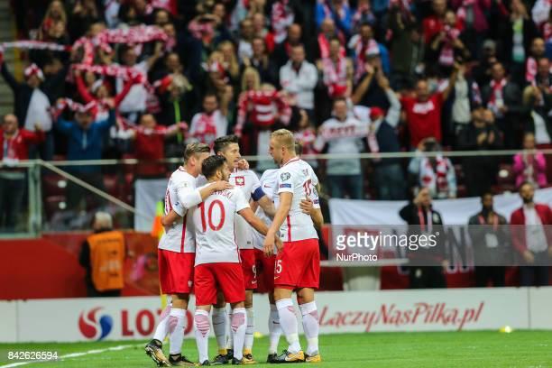 Arkadiusz Milik celebrates his goa with Maciej Makuszewski Lukasz Piszczek Kamil Glik during the FIFA World Cup 2018 qualification match between...