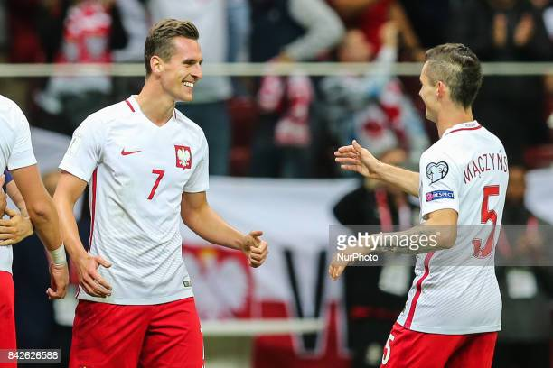 Arkadiusz Milik celebrates his goal with Krzysztof Maczynski during the FIFA World Cup 2018 qualification match between Poland and Kazakhstan in...