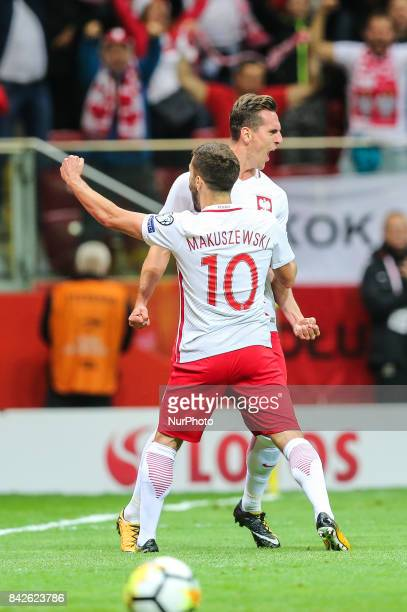 Arkadiusz Milik celebrates his score goal with Maciej Makuszewski during the FIFA World Cup 2018 qualification match between Poland and Kazakhstan in...