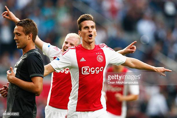 Arkadiusz Milik of Ajax celebrates scoring his teams first goal of the game from the penalty spot during the UEFA Europa League play off round 1st...