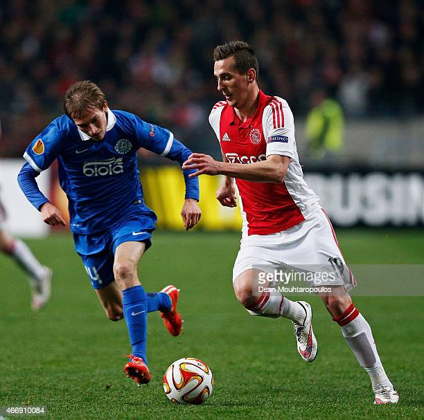 Arkadiusz Milik of Ajax is pursued by Valeriy Luchkevych of Dnipro during the UEFA Europa League Round of 16 second leg match between AFC Ajax v FC...