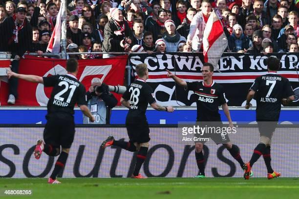 Arkadiusz Milik of Augsburg celebrates his team's first goal with team mates Dominik Kohr Andre Hahn and Halil Altintop during the Bundesliga match...