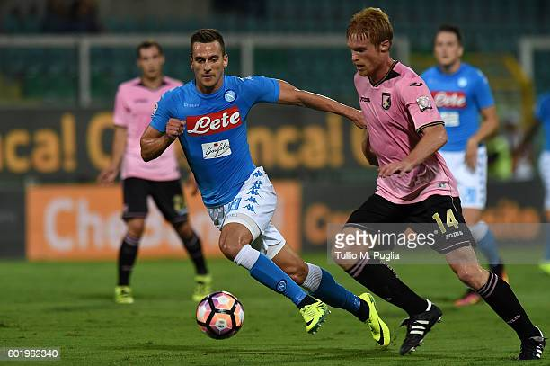 Arkadiusz Milik of Napoli and Alessandro Gazzi of Palermo compete for the ball during the Serie a match between US Citta di Palermo and SSC Napoli at...