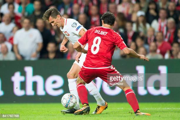 Arkadiusz Milik of Poland and Thomas Delaney of Denmark during the FIFA World Cup 2018 Qualifying Round between Denmark and Poland at Telia Parken...
