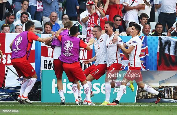 Arkadiusz Milik of Poland celebrates after he scores the opening goal during the UEFA EURO 2016 Group C match between Poland v Northern Ireland at...