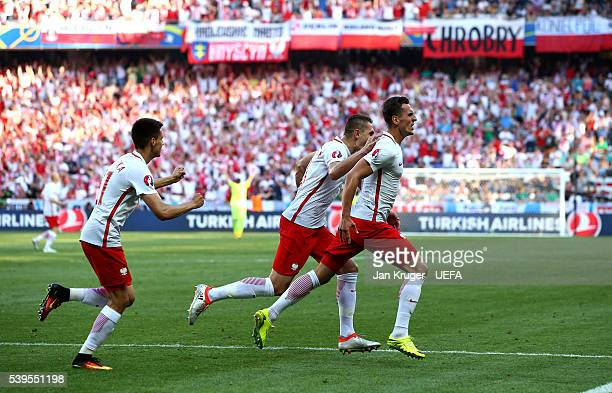 Arkadiusz Milik of Poland celebrates scoring his team's first goal with his team mates during the UEFA EURO 2016 Group C match between Poland and...