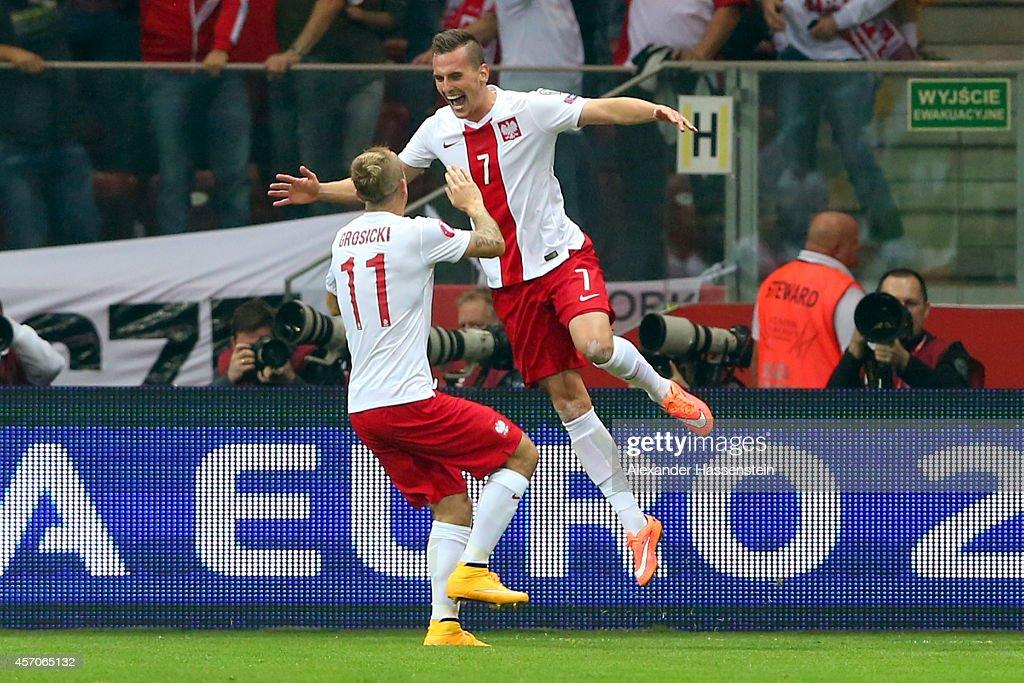 Arkadiusz Milik of Poland celebrates scoring the opening goal with his team mate Kamil Grosicki during of the EURO 2016 Group D qualifying match...