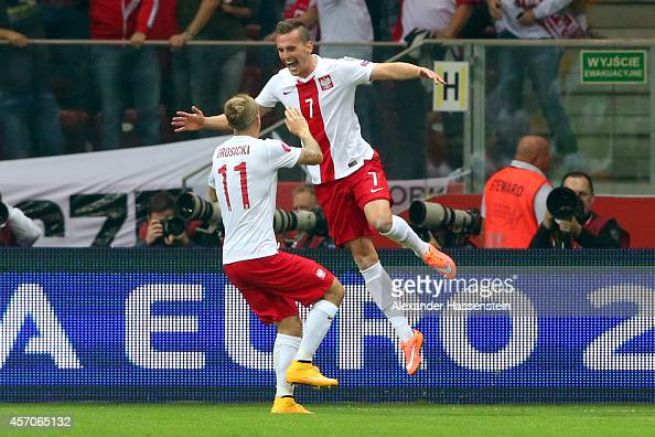 Arkadiusz Milik of Poland celebrates scoring the opening goal with his team mate Kamil Grosicki during of the EURO 2016 Group D qualifying match...