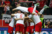 Arkadiusz Milik of Poland celebrates with team mates after scoring his team's first goal during the EURO 2016 Group D qualifying match between Poland...
