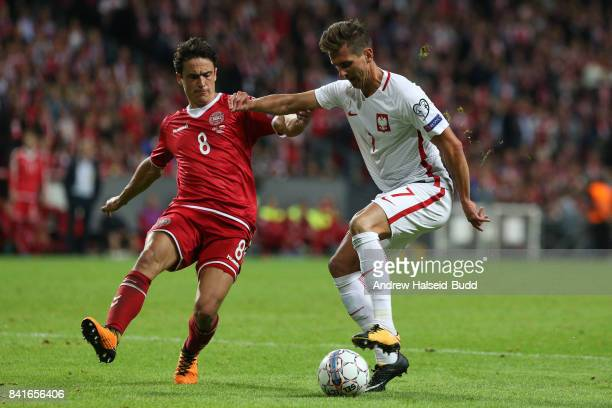 Arkadiusz Milik of Poland in action against Thomas Delaney of Denmark during the FIFA 2018 World Cup Qualifier between Denmark and Poland at Parken...