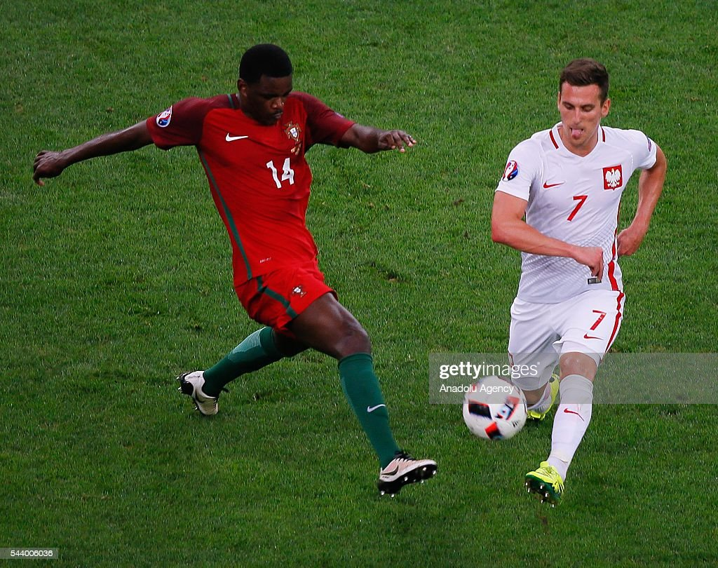 Arkadiusz Milik (7) of Poland in action against William Carvalho (14) of Portugal during the Euro 2016 quarter-final football match between Poland and Portugal at the Stade Velodrome in Marseille, France on June 30, 2016.