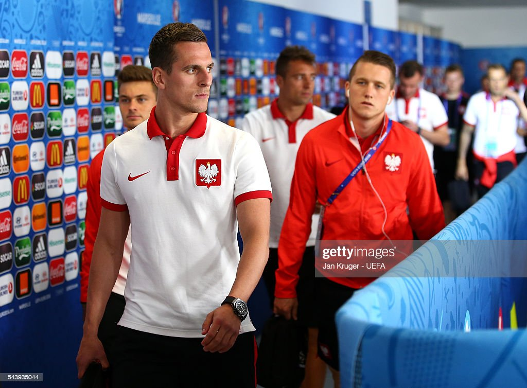 <a gi-track='captionPersonalityLinkClicked' href=/galleries/search?phrase=Arkadiusz+Milik&family=editorial&specificpeople=9852666 ng-click='$event.stopPropagation()'>Arkadiusz Milik</a> of Poland is seen on arrival at the stadium prior to the UEFA EURO 2016 quarter final match between Poland and Portugal at Stade Velodrome on June 30, 2016 in Marseille, France.