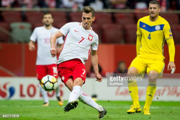 Arkadiusz Milik of Poland kicks the ball during the FIFA World Cup 2018 Qualifying Round match between Poland and Kazakhstan at National Stadium in...