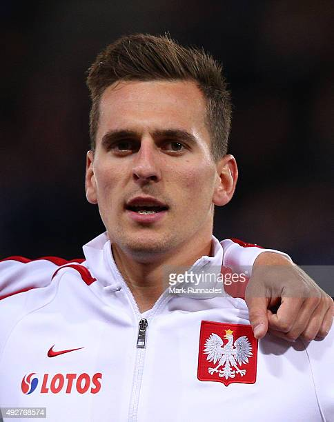 Arkadiusz Milik of Poland lines up for the national anthem during the EURO 2016 Qualifier between Scotland and Poland at Hamden Park on October 8...