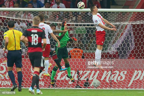 Arkadiusz Milik of Poland scores the opening goal against Manuel Neuer keeper of Germany during of the EURO 2016 Group D qualifying match between...