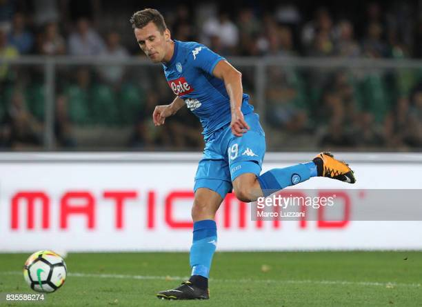 Arkadiusz Milik of SSC Napoli scores his goal during the Serie A match between Hellas Verona and SSC Napoli at Stadio Marcantonio Bentegodi on August...