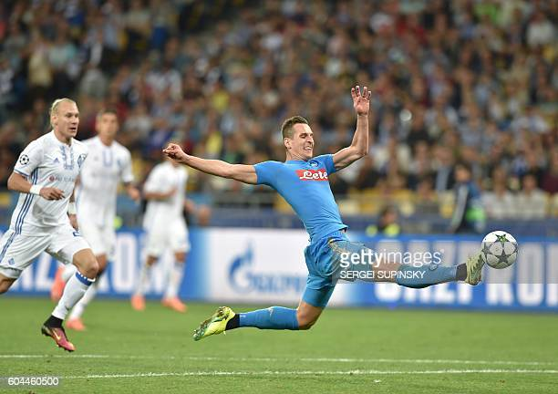 Arkadiusz Milik vies for the ball with Domagoj Vida during their Champions League football match between FC Dynamo and SSC Napoli at the Olympiyski...