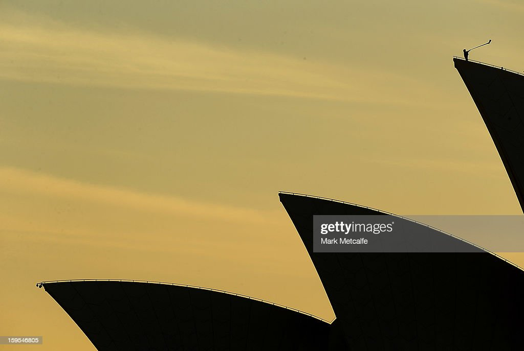 Arkady Shilkloper plays his three-metre long alphorn on the top of the largest sail of the Sydney Opera House as part of the Sydney Festival at the Sydney Opera House on January 16, 2013 in Sydney, Australia.