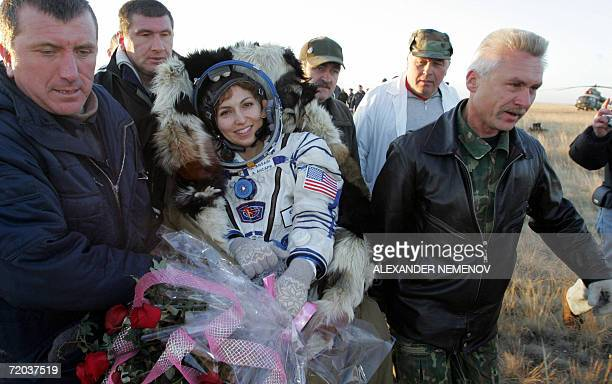 The world's first female space tourist Anousheh Ansari is being transported to a helicopter after landing of the Russian 'Soyuz TMA8' space capsule...