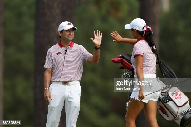 Arkansas assistant coach Mike Adams with Dylan Kim during the third and final round of the Ruth's Chris Tar Heel Invitational Women's Golf Tournament...