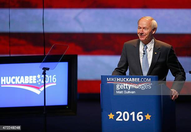 Arkansas Governor Asa Hutchinson speaks to the audience before former Arkansas Governor Mike Huckabee announces his candidacy for the 2016...