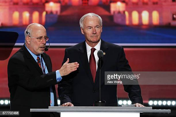 Arkansas Governor Asa Hutchinson stands on stage prior to the start of the second day of the Republican National Convention on July 19 2016 at the...