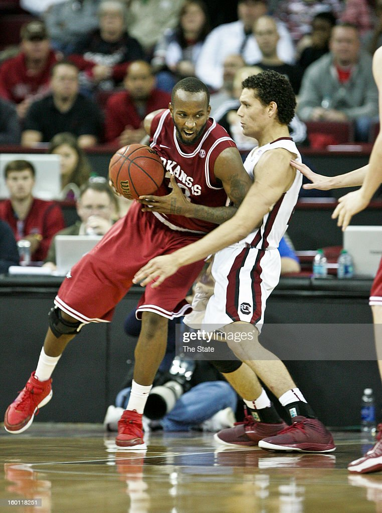 Arkansas' Marshawn Powell, left, works off the dribble against South Carolina's Michael Carrera in the first half at Colonial Life Arena in Columbia, South Carolina, on Saturday, January 26, 2013. South Carolina won, 75-54.