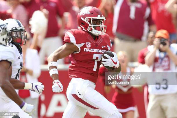 Arkansas Razorback Jonathan Nance runs with the ball in the game between the TCU horned Frogs and the Arkansas Razorbacks on September 9 2017 at...