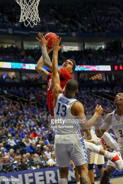 Arkansas Razorbacks forward Dustin Thomas drives to the basket during the first half of the Southeastern Conference Basketball Championship Game...