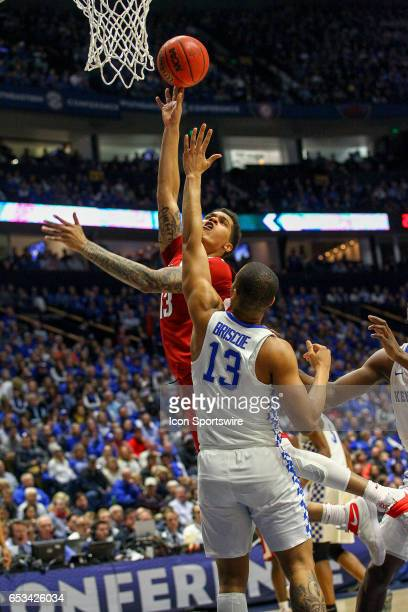 Arkansas Razorbacks forward Dustin Thomas shoots the ball during the Southeastern Conference Basketball Championship Game between the Kentucky...