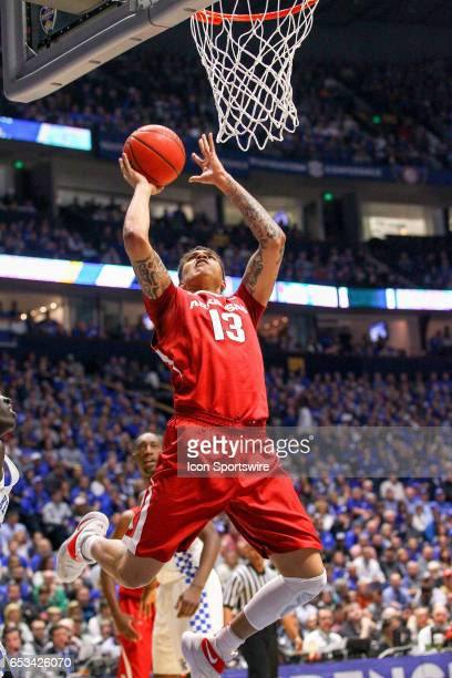 Arkansas Razorbacks forward Dustin Thomas shoots the ball during the first half of the Southeastern Conference Basketball Championship Game between...