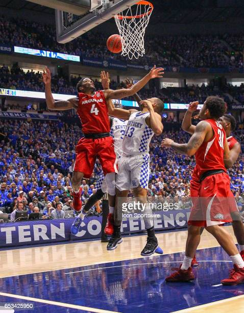 Arkansas Razorbacks guard Daryl Macon and Kentucky Wildcats guard Isaiah Briscoe go for the rebound during the Southeastern Conference Basketball...