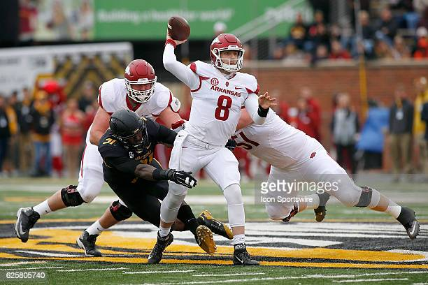 Arkansas Razorbacks quarterback Austin Allen throws a pass while under pressure from Missouri Tigers defensive end Charles Harris during the first...