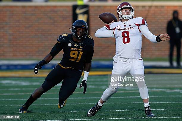 Arkansas Razorbacks quarterback Austin Allen throws a pass while under pressure from Missouri Tigers defensive end Charles Harris during the second...