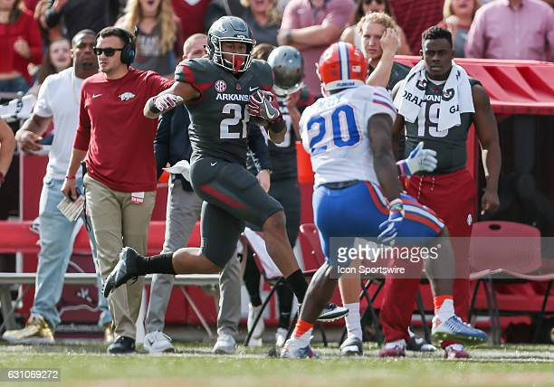 Arkansas Razorbacks running back Devwah Whaley runs up the sideline as Florida Gators defensive back Marcus Maye closes in during an NCAA football...