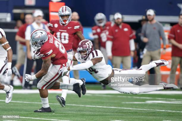 Arkansas Razorbacks running back Devwah Whaley tries to break away from Texas AM Aggies safety Keldrick Carper during the college football game...