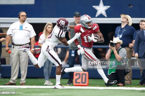 Arkansas Razorbacks wide receiver Jordan Jones tries to break away from Texas AM cornerback Myles Jones during the college football game between the...