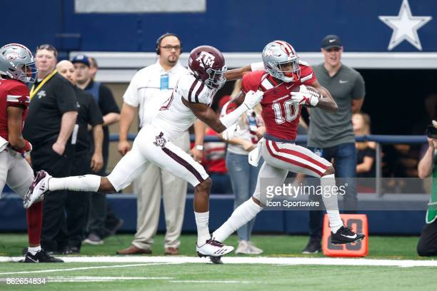 Arkansas Razorbacks wide receiver Jordan Jones tries to break away from the tackle of Texas AM Aggies cornerback Myles Jones during the college...