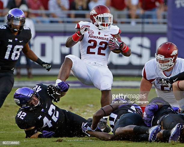 Arkansas running back Rawleigh Williams III is brought down by the ankles by the TCU defense in the first quarter at Amon G Carter Stadium in Fort...