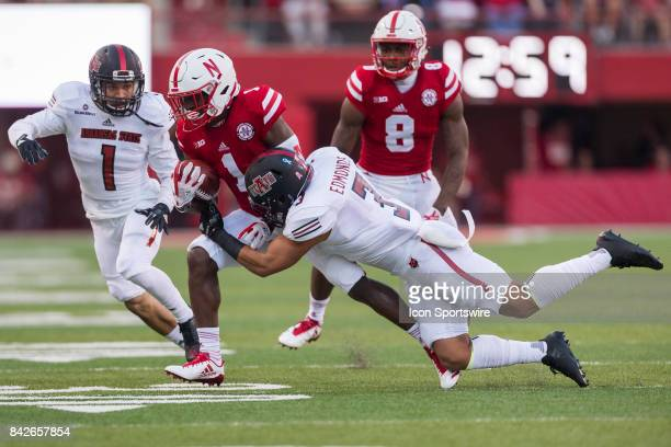 Arkansas State Red Wolves offensive lineman BJ Edmonds tackles Nebraska wide receiver Tyjon Lindsey during the first half against the Arkansas State...