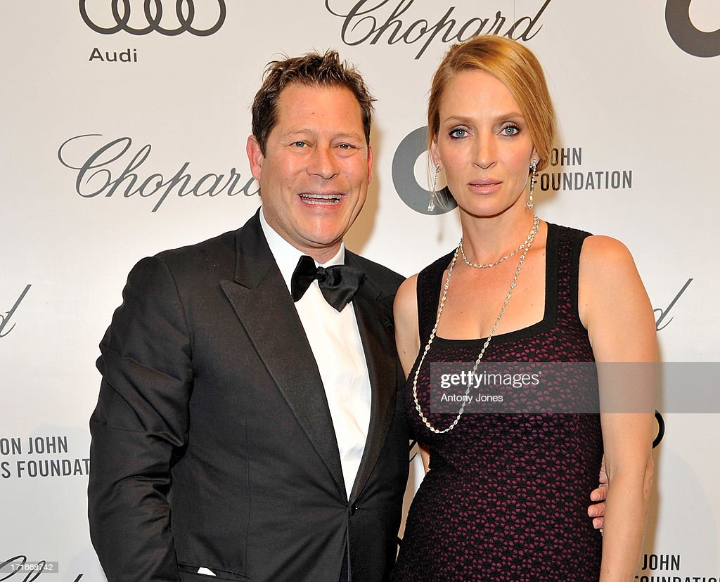 Arki Busson (L) and Uma Thurman attend the 15th Annual White Tie and Tiara Ball to Benefit Elton John AIDS Foundation in Association with Chopard at Woodside on June 27, 2013 in Windsor, England. No sales to online/digital media worldwide until the 14th of July. No sales before July 14th, 2013 in UK, Spain, Switzerland, Mexico, Dubai, Russia, Serbia, Bulgaria, Turkey, Argentina, Chile, Peru, Ecuador, Colombia, Venezuela, Puerto Rico, Dominican Republic, Greece, Canada, Thailand, Indonesia, Morocco, Malaysia, India, Pakistan, Nigeria. All pictures are for editorial use only and mention of 'Chopard' and 'The Elton John Aids Foundation' are compulsory. No sales ever to Ok, Now, Closer, Reveal, Heat, Look or Grazia magazines in the United Kingdom. No sales ever to any jewellers or watchmakers other than Chopard